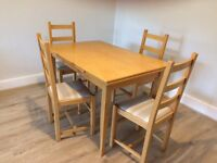 Solid wooden extending table with four chairs