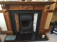 Cast iron gas fire with wooden surround
