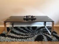 """Black glass coffee table measures (48"""" long x 26"""" wide x 16"""" high)"""