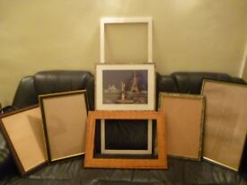 seven mixed photo frames with and without glasses,one has lovely paris eifel tower picture,£10.all.