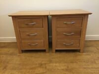 Two solid oak bedside cabinets