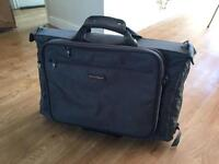 Suit carrier with detachable briefcase