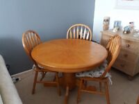 Round table and 3 chairs with seat cushions