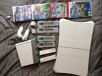 Black Nintendo Wii, Balance Board, Motion Plus Controllers cases and games