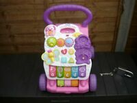 V TECH PINK MUSICAL MY FIRST STEPS BABY WALKER