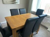 Extendable Oak dining table with 6 chairs