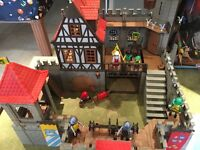 Playmobil Medieval Castle 3666. Built includes board built on. Smoke free home.