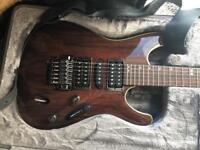 Ibanez Premium guitar with Roland cube amp and korg tuner