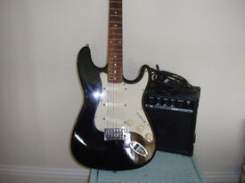 6 STRING ENCORE ELECTRIC GUITAR AND AMPLIFIER IN VERY GOOD CONDITION..
