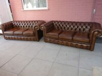 A Pair Of Tanny/Gold Brown Leather Chesterfield Three Seater Sofas