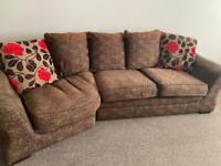 Brown curved corner sofa