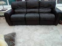 Chocolate brown leather three seater reclining settee