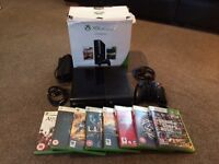 Boxed Xbox 360 250e in exellent condition with 8 games