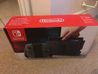 Nintendo switch in box with Mario kart 8