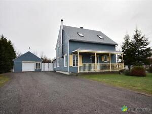 244 500$ - Maison à un étage et demi à St-Honore-De-Chicoutim