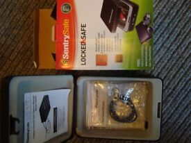 Used. Sentry Locked Safe combination lock steel tethering cable. keys, tablets, security etc.