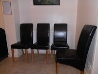 6 Faux leather chairs in very good condition