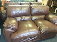 Brown leather 3 x 2 sofas can deliver