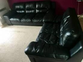 Black leather sofas dfs