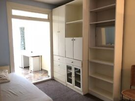 A studio with a shared kitchen and office/study area near Middx University