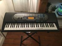 Casio CTK-571 Keyboard with stand, power adaptor, instructions and song book