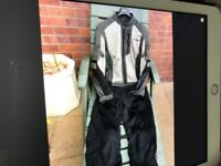 Mans Revit 2 piece Textile motorcycle suit in immaculate condition with full body armour