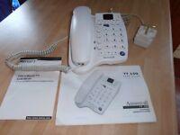 "A TT 150. ""ANSWERCALL"" A white telephone Receiver / Answer machine,"