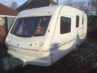 Elddis Typhoon family caravan with Isabella awning and winter cover