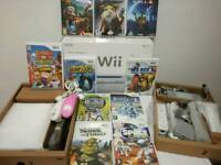 Boxed Nintendo Wii console in excellent condition with 2 controllers and 10 games