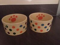 Two dog bowls. Spotty patterned in good condition.
