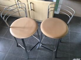 Pair of Bar Stools, beige leather seat base, brushed metal frame