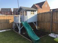 Wooden garden house and slide