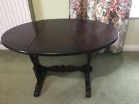 Mini drop leaf / folding oval coffee table - dark brown