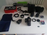Sony Alpha 55 SLR camera with 3 lenses and accessories