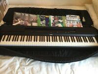 Yamaha p255 digital piano, case and tutor books