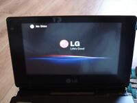 LG DP581B dvd and cd player in box