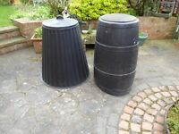 Two plastic compost bins with lids