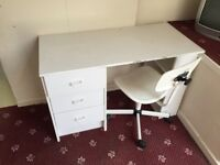 White wooden desk and swivel chair