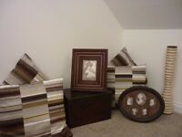 Selection of homeware: picture frames, cushions, storage box and vase