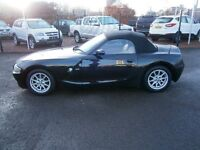2 DOOR CONVERTIBLE, BLACK WITH RED LEATHER INTERIOR