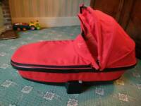 Red Quinny foldable carry cot