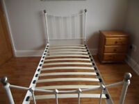 Metal Single Bed Frame in Off-White/ Ivory with Antique Brass Knobs.