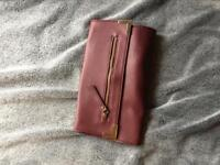 Burgundy clutch bag