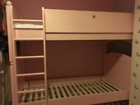 Quality solid wood Feather and Black bunk beds pink. Excellent condition. Immediate uplift