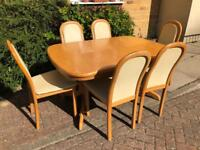 Hulsta extendable dining table and 6 chairs. Can deliver.