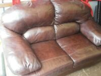 BROWN 2-SEAT LEATHER SOFA at Haven Housing Trust's charity shop
