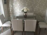 Glass dining table ans 6 chairs