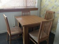 REIDS flip top extending dining room table and four chairs-As New - in store 899