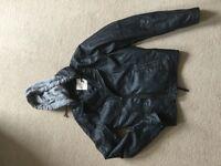Holistic leather jacket with soft hoodie hood.