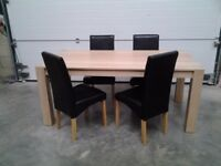 Ex display Less 1/3 shop price. Dining table and 4 chairs in black faux. Very good, Can deliver.